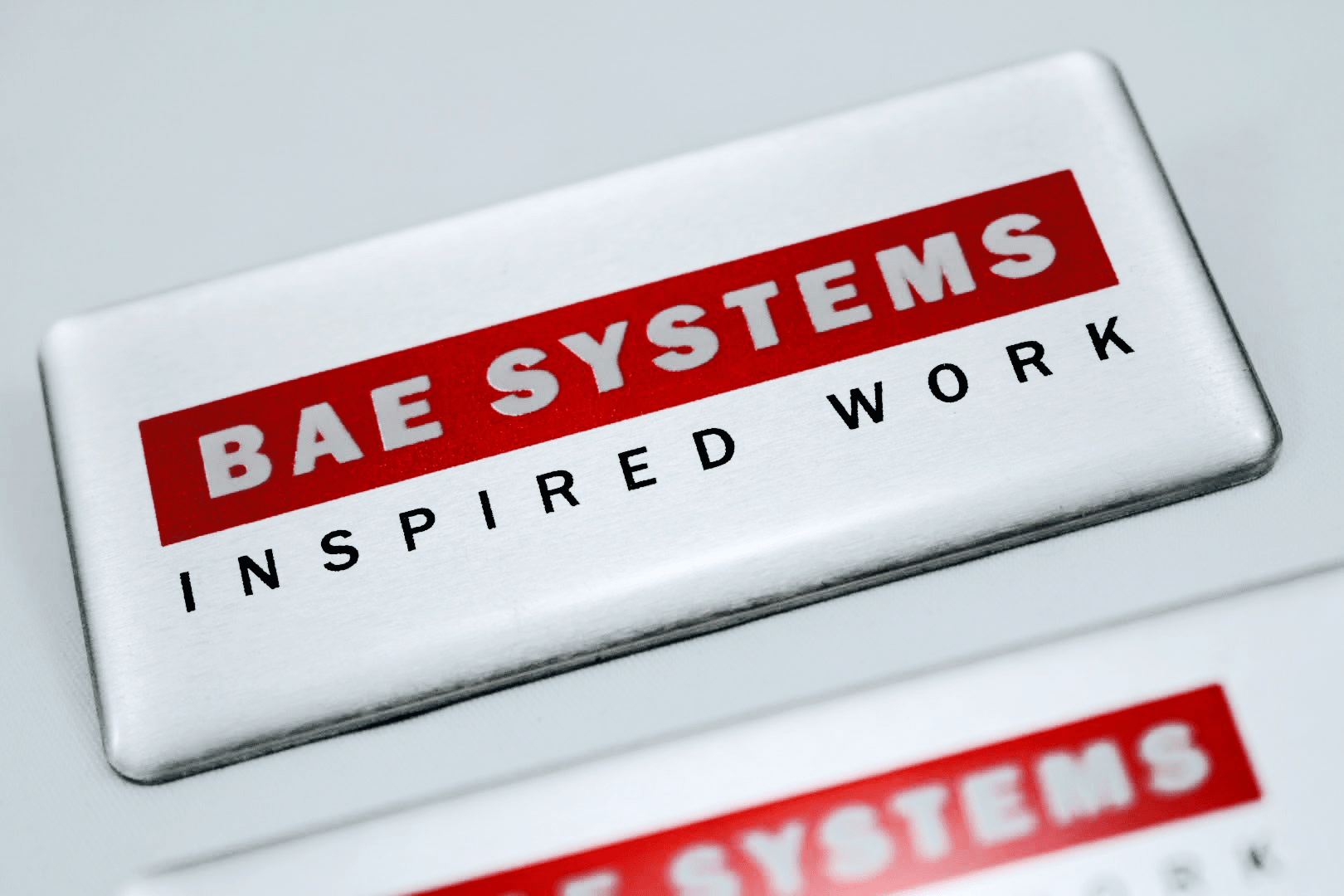 Promotional Digitally Printed Metal Name Badges, Printed and Delivered to BAE Systems.