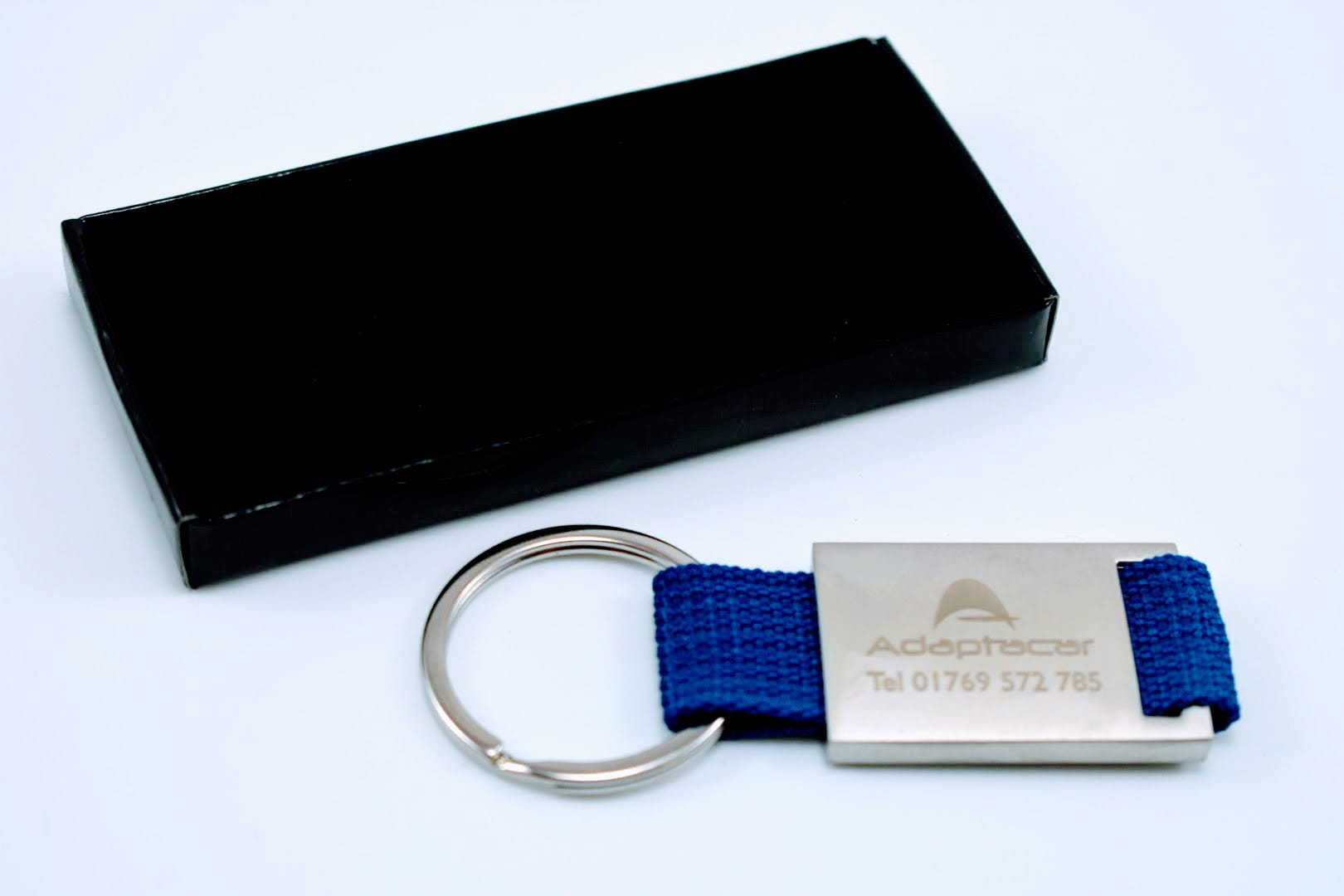 Promotional Metal And Canvas Keyrings, Printed and Delivered to Adaptcar.